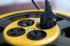 A plug plugged Stock Photography