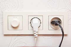 Plug in the power socket Royalty Free Stock Photography