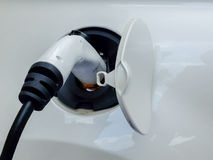 Plug for recharge electric vehicles. Detail of the plug of a recharging station for electric vehicles Stock Photos