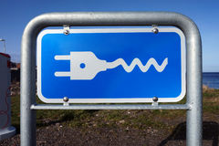 Plug-in sign for electrical cars Royalty Free Stock Photography