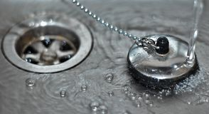Plug in sink with water Stock Images