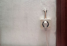Plug socket on gray concrete wall Royalty Free Stock Photos