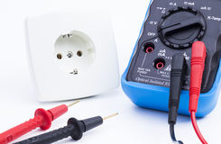 Plug socket and multimeter Stock Photography