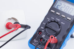 Plug socket and multimeter Royalty Free Stock Image