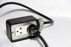 Plug in socket outlet with black cable on the white background. Used for electrical connection. Long distance between the outlet of electric and electric royalty free stock photography