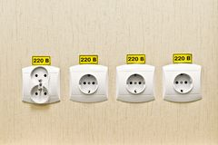 Plug socket 220 volt on the wall of the office. Premises Stock Photography