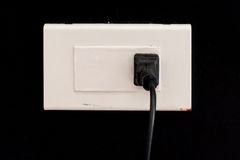 Plug socket on wall Stock Photo