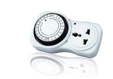 Plug-in timer mechanical 24 hour. Indoor home tools. Plug-in timer socket set isolated on white background. Mechanical outlet time royalty free stock photography