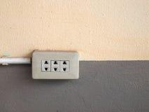Plug on wall. Stock Photos