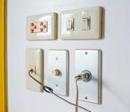 plug on wall Stock Photo