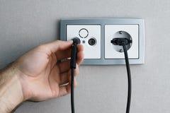 Plugga kabel till uttag royaltyfri fotografi