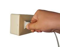 Pluggat in eller koppla från den elektriska proppen Arkivfoton