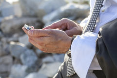 Plugged everywhere. A business man checking his smartphone by the mediterranean Stock Image