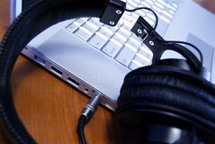 Plugged in Headphones 2. Headphones plugged into a modern laptop royalty free stock image