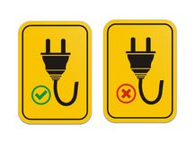 Plugged and un-plugged yellow signs Royalty Free Stock Photography