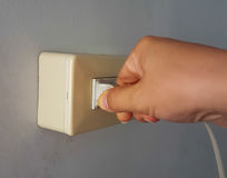 Plugged in or Unplug electric plug. On the wall background stock images