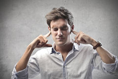Plugging the Ears. A man is plugging his ears Stock Photos