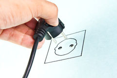 Plugging electrical cable to sketching socket Stock Images