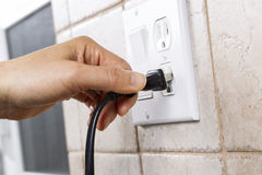 Plugging into Electrical Outlet stock photos