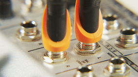 Plugging Orange Cables to Slots stock footage