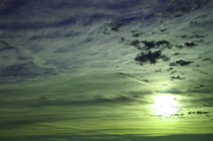 Plugging sun in a evening sky. Beautiful white clouds in the blue evening sky Stock Photo