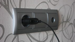 Plugging and unplugging a power adapter. stock video