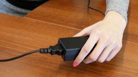Plugging and unplugging to an extension cord. Woman Plugging and unplugging  to an extension cord stock video