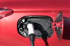 Plugin Hybrid charging. With electricity Royalty Free Stock Photo