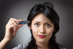 Pluging memory stick into head Royalty Free Stock Images