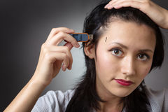 Pluging memory stick into head Stock Photography