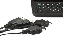 plugs den laddande tangentbordmobilen för mobiltelefon usb Arkivfoton
