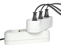 Plugs in electric socket. Isolated Royalty Free Stock Photo