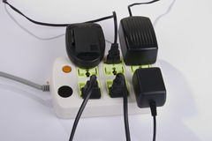Plugs in electrical outlet Stock Photos
