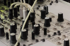 Plugs and knobs - modular synthesizer, analogue synth closeup Royalty Free Stock Photos