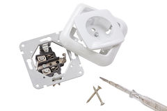 Plugs, screws and screwdriver Stock Photo