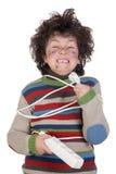 Plugue da criança que recebe choque eléctrico Imagens de Stock