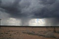 Pluie dans le désert Photographie stock