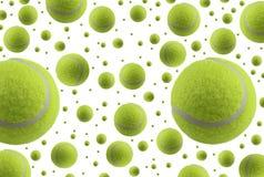 Pluie de billes de tennis d'isolement sur le fond blanc Photographie stock