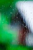 Pluie sur un hublot Photo libre de droits