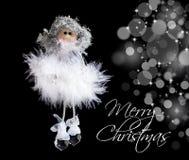 Pluizige engel en Kerstmislichten Stock Foto