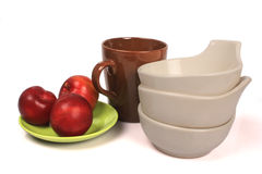 Plum,bowls, plates ,cups Royalty Free Stock Photos