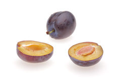 Plum. Cut plum on white background Royalty Free Stock Images