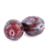 Plum. Ripe plum on white background (isolated, clipping path Royalty Free Stock Images