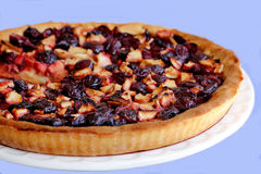 A plum apple pie. A freshly baked apple pie plums Royalty Free Stock Image