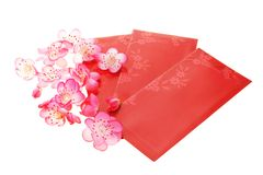 Plum blossoms and red packets Stock Photography