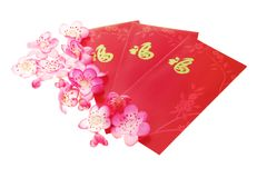 Plum blossoms and red packets Royalty Free Stock Photo