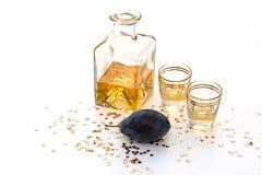 Plum brandy. COMPOSITION WITH hungarian plum BRANDY Stock Photos