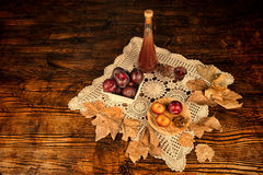 Plum brandy still life Royalty Free Stock Photos