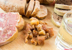 Plum brandy and traditional pork dishes. Brandy and romanian traditional christmas pork dishes Royalty Free Stock Images