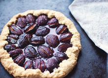 Plum cake. From the pan with a napkin Stock Image